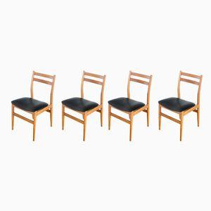 Französische Esszimmerstühle aus Kunstleder & Eiche, 1970er, 4er Set