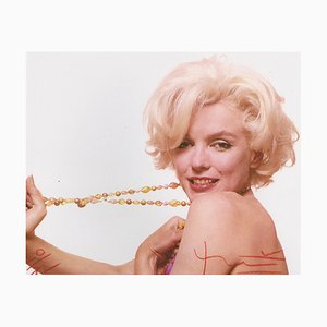 Marilyn Stretching the Jewelry Photograph by Bert Stern, 2010