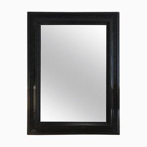 Specchio grande con cornice in legno intagliato ebanizzato, anni '20