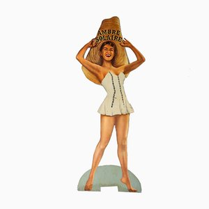 Mid-Century Plywood and Paper Ambre Solaire Pinup Girl Sign, 1950s