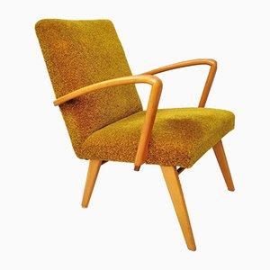 Schwedischer Mid-Century Armlehnstuhl aus Holz mit senfgelbem Bezug, 1970er