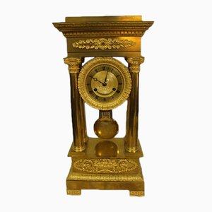 Reloj de péndulo de bronce dorado, siglo XIX