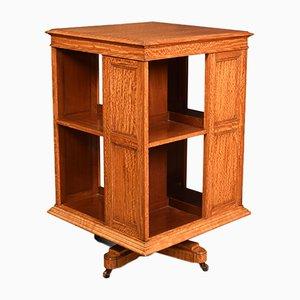 Libreria girevole antica in legno di seta
