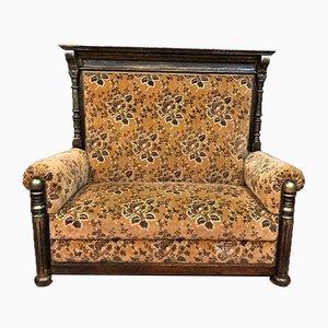 Sofá antiguo de terciopelo