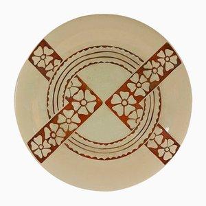 Piatto geometrico con motivi floreali di Roger Mequinion, anni '40