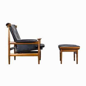 Conjunto de sillón y otomana danés de cuero y teca de Finn Juhl para France & Søn, años 50