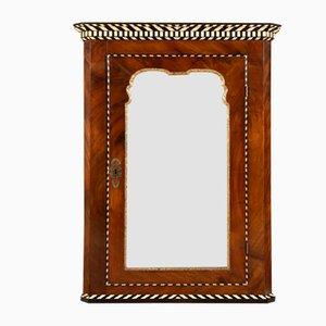 Alacena antigua de caoba con espejo
