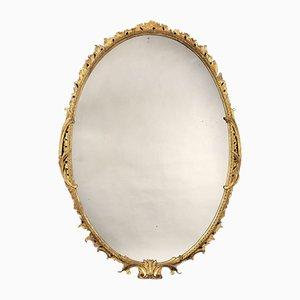Specchio Giorgio III ovale in legno dorato intagliato, XVIII secolo