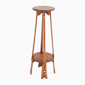 Mesa pedestal modernista antigua de roble