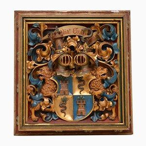 Antikes französisches Wappen aus geschnitztem Holz