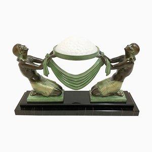 Escultura Offrande iluminada de Pierre Le Faguay para Max Le Verrier