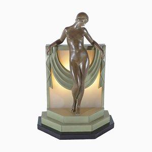 Escultura Sérénité iluminada de Pierre Le Faguay para Max Le Verrier