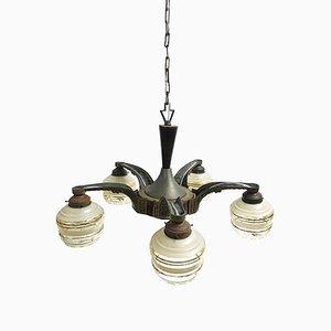 Lámpara de araña francesa Art Déco de bronce y madera, años 30