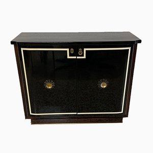 Mueble estilo Art Déco de latón y madera lacada en negro, años 40