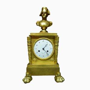 Reloj de péndulo antiguo de bronce dorado