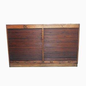 Mueble industrial con cierre de persiana, años 30