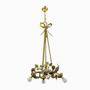 Lámpara de araña francesa neoclásica de latón y bronce, años 20