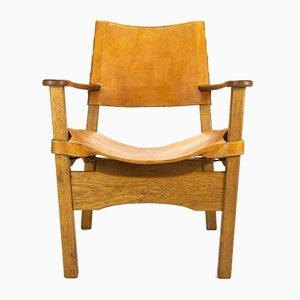 Dänischer Sessel aus Leder & Eichenholz, 1960er