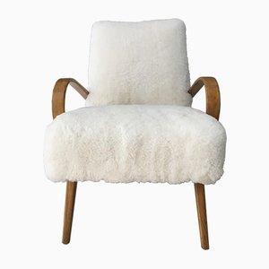 Poltrona estilo Art Déco de madera curvada y piel de oveja de TON, años 60