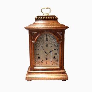 Reloj alemán antiguo de roble