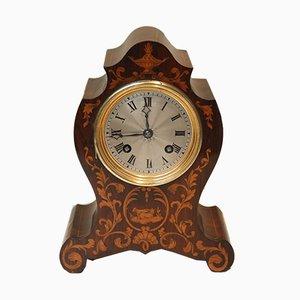 Reloj de repisa antiguo pequeño de palisandro y marquetería