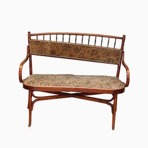 Canapé antiguo de madera curvada