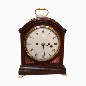 Reloj antiguo de vidrio y caoba