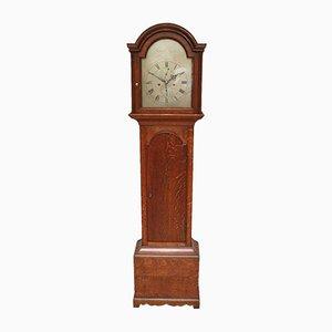 Reloj antiguo pequeño de roble