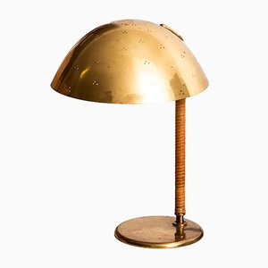 Brass and Cane Table Lamp by Paavo Tynell for Taito Oy, 1940s