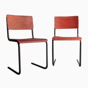 Sillas de escritorio alemanas estilo Bauhaus de contrachapado y metal, años 50. Juego de 2
