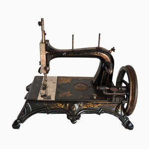 Máquina de coser vintage portátil de Junker & Ruh