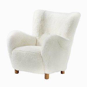 Dänischer Mid-Century Sessel mit Gestell aus Eiche & Schafsfellbezug, 1940er