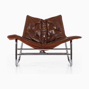 Poltrona de acero cromado y cuero marrón, años 60