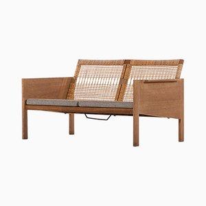 Sofá danés de tela y roble de Kai Kristiansen para Christian Jensen Møbelsnedkeri, años 60