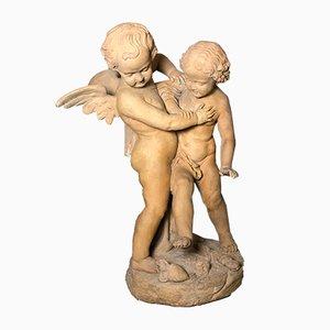 Sculpture d'Anges se Battant Antique en Terracotta