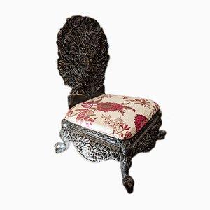 Antiker schwarzer Kinderstuhl aus geschnitzter