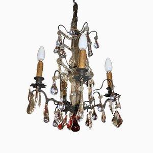 Lámpara de araña francesa vintage de bronce y cristal, años 20