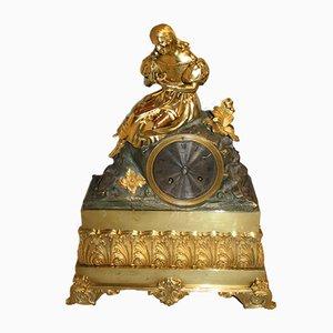 Reloj francés de estilo Imperio antiguo de bronce y oro