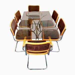 Juego de mesa de cristal ahumado y seis sillas vintage, años 80