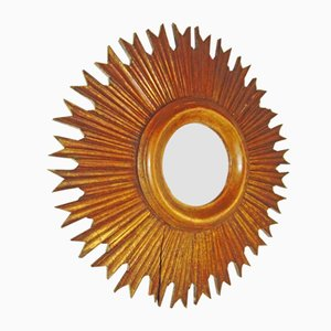 Espejo vintage en forma de sol de madera dorada, años 20