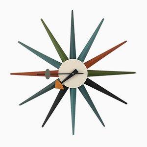 Reloj italiano en forma de sol de roble y acero de George Nelson para Vitra, años 90
