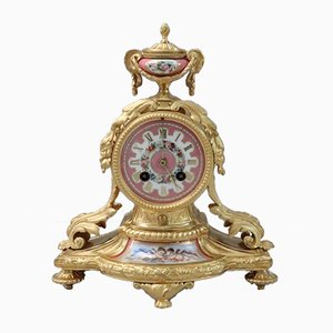 Reloj de repisa francés estilo Luis XVI de bronce dorado y porcelana de Vincenti, década de 1860
