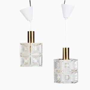 Lámparas de araña de latón y cristal de Carl Fagerlund para Orrefors, años 60. Juego de 2