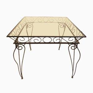 Mesa de jardín italiana de hierro y vidrio coloreado de Case e Giardino, años 50