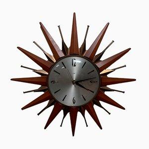 Reloj de pared en forma de sol vintage de teca de Metamec, años 70