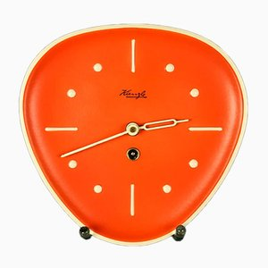 Orangefarbene Wanduhr aus Keramik & Messing von Kienzle International, 1950er