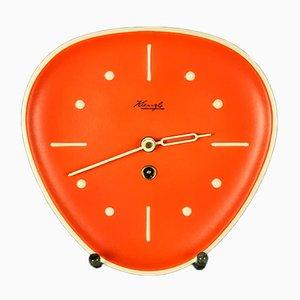 Reloj de pared de cerámica naranja y latón de Kienzle International, años 50