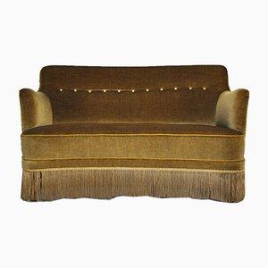 Geschwungenes Vintage Sofa mit grün-gelbem Bezug