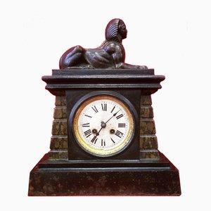 Reloj antiguo con esfinge