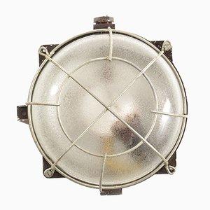 Industrielle Wandleuchte aus Bakelit, Glas & Metall, 1950er